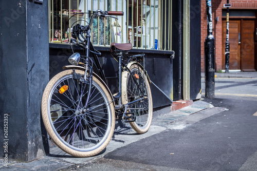 Bicycle leaning against a shop window