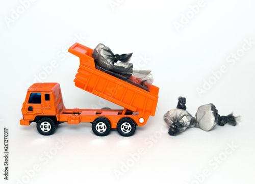 toy garbage truck with garbage bags isolated on white background