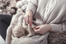 Vintage Wooden Knitting Needles And Yarn In Woman's Hands