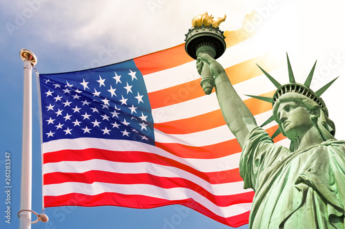 Statue of Liberty, sunny sky and USA flag background Wallpaper Mural