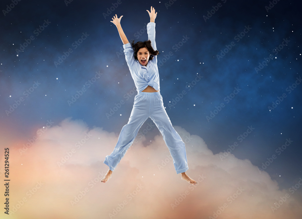 Fototapety, obrazy: fun, people and bedtime concept - happy young woman full of energy in blue pajama jumping over starry night sky background
