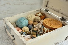 Spools With Threads, Yarn Balls In A White Box For Needlework In Vintage Style.
