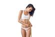 canvas print picture - Schlanke Frau misst ihre Taille