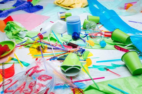 Fotografie, Obraz  Close up of varied plastic items lying on the floor