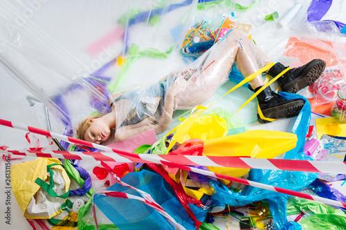 Fotobehang Paradijsvogel bloem Model closing eyes while posing on floor wrapped into plastic