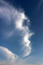 Fine Wispy Cloud Forming A Shape Resembling A Side Profile Of A Human Face