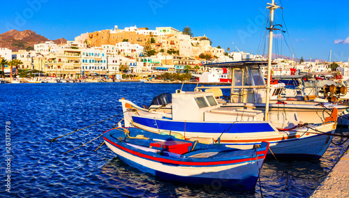 Greek holidays - scenic port of Naxos island, view with old fishing boats, Cyclades, Greece