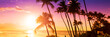 canvas print picture - Palm tree silhouette on a background of tropical sunset