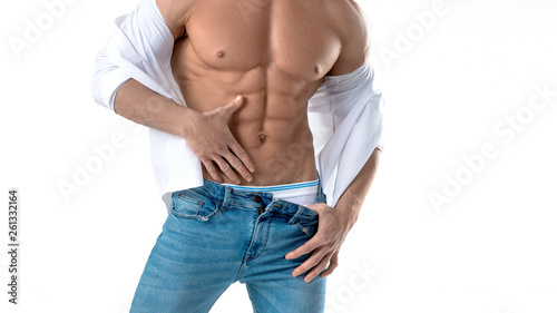 Stampa su Tela  Muscular male torso in white shirt and blue jeans isolated on white