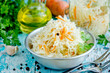 Homemade sauerkraut with carrot and spices, sweet and sour white cabbage