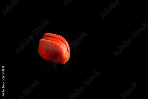 Fotografie, Obraz  single small red oval-shaped chocolate candy with decoration
