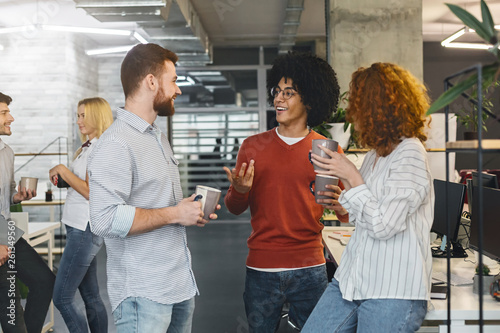 Fényképezés  Diverse millennials enjoying communication in modern office