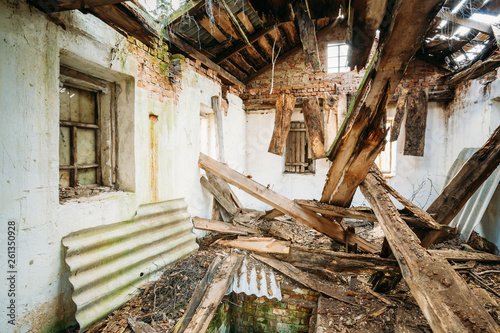 Fototapeta Belarus. Interior Of Ruined Abandoned Private Country House With Caved Roof In Evacuation Zone After Chernobyl Disaster. Terrible Consequences Of Nuclear Contamination obraz