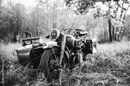 Fototapety, obrazy: Old Tricar, Three-Wheeled Motorbike Of Wehrmacht, Armed Forces Of Germany Of World War II Time In Summer Forest. Photo In Black And White Colors
