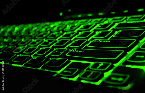 Photo  Backlight gaming keyboard with green color schemes