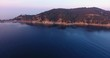 Aerial shot of beautiful sunset on the calm sea in Elba island in Tuscany It