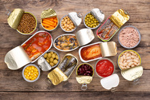 Canned Food On Wooden Background, Top View