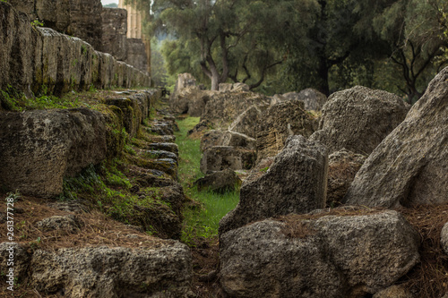 Fotografiet  ancient civilization stone abandoned ruins of unknown temple building in forest