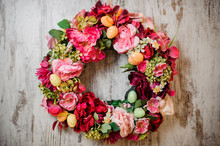 Beautiful Spring Composition Of The Big Wreath Of Pink Flowers Decorated With Little Toy Eggs