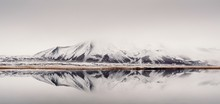 Picturesque View Of Lake And Coast With Snowy Mountain In Iceland