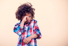 Sad Kid With Curly Hair Over Isolated Background