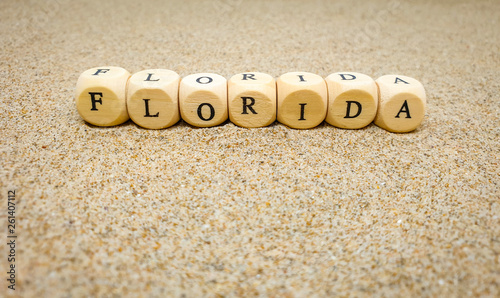 Fotografia, Obraz  florida word built with wooden cubes and black letters on the floor and bottom o