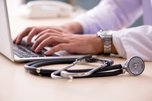 Young Male Doctor In Telemedicine Concept