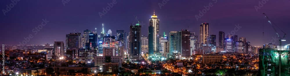 Fototapeta Wide panorama of Bonifacio Global city skyline at Magic hour