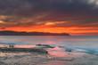 Orange Lights the Sky Cloudy Sunrise Seascape