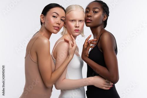 Obraz na płótnie Models wearing camisoles posing for diversity magazine