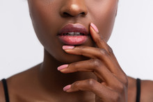 African-American Woman Touching Lips With Shiny Lip Gloss