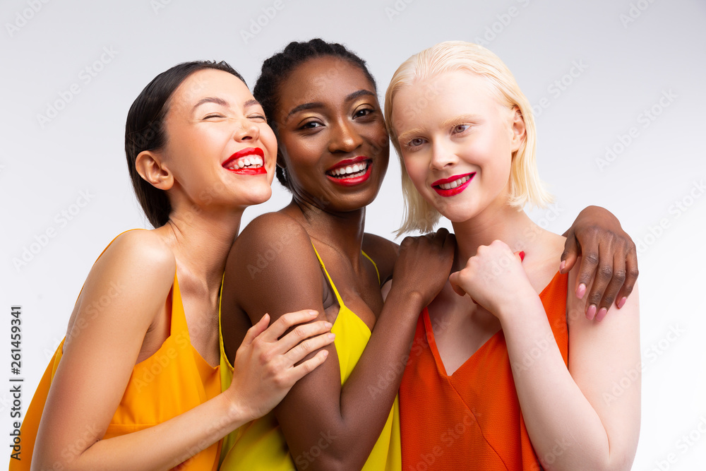 Fototapeta Women with different skin color having bright red lips