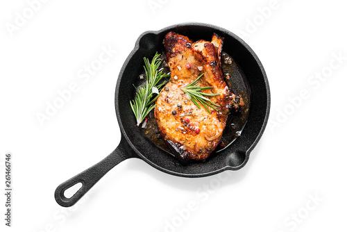 Fototapeta Fried pork steak in frying pan  isolated on white background.  obraz
