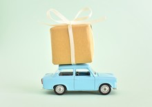 Happy Fathers Day Concept, Blue Retro Toy Car Delivering Gift Box, Greeting Card.
