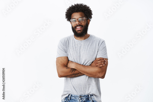 Portrait of delighted calm and handsome african american male coworker in glasse Wallpaper Mural