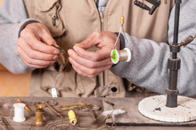 Man Making Trout Flies. Fly Ty...