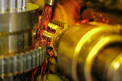 Fotomural Gear cutting, gear manufacturing, technical oil cools the part during processing