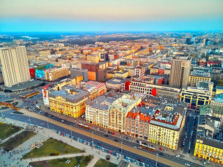 Fototapeta Warszawa WARSAW, POLAND - APRIL 07, 2019: Beautiful panoramic aerial drone view to the center of Warsaw City in the sunset time in spring
