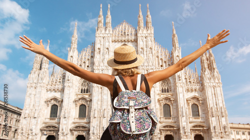 Obraz Happy traveler girl in Milan city. Tourist woman posing near Duomo cathedral in Milan, Italy, Europe - fototapety do salonu