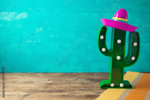 Fotografie, Obraz  Cinco de Mayo holiday background with Mexican cactus and  party sombrero hat on