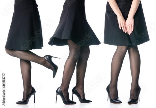 Fotografija Set female legs in black high heels shoes black skirt fashion on white backgroun