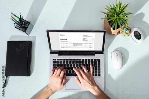 Keuken foto achterwand Eigen foto Businessperson Checking Invoice On Laptop