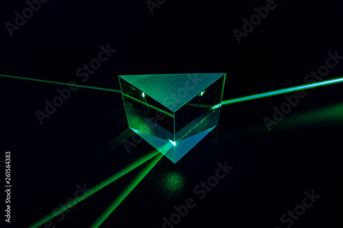 Valokuva  Laser beam and optical glass on black background