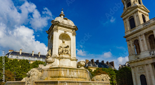 Fountain in front of the church of Saint-Sulpice in cloudy blue sky day in Paris Canvas Print