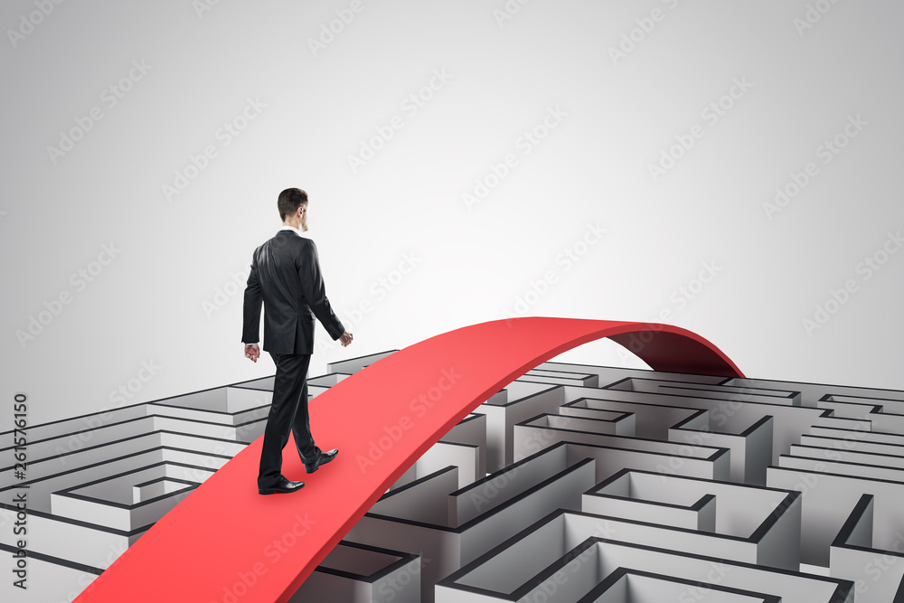 Fototapeta Businessman overcoming maze