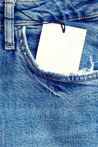 Fotomural  Blue denim fabric with a pocket as a background.