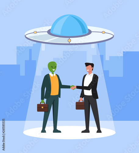 Alien and human business man character shaking hand and making deal Canvas Print