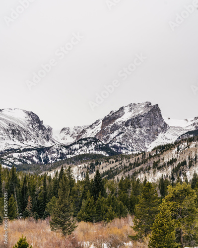 Mountain Peaks with Snow and Clouds in the Colorado Rocky Mountain National Park