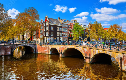Fototapety, obrazy: Bridge over channel in Amsterdam Netherlands houses river Amstel landmark old european city spring landscape.
