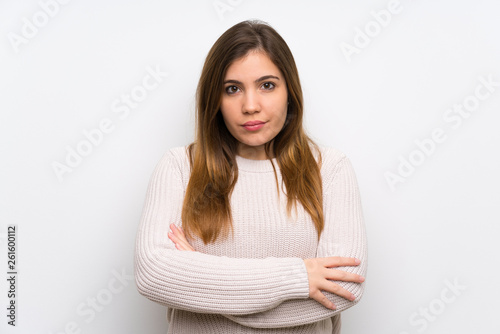 Fototapety, obrazy: Young girl with white sweater keeping arms crossed